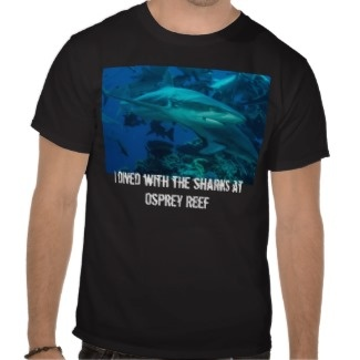 What can I say but lots of sharks!!!  As far as the T Shirt goes - comfortable, casual and loose fitting, our heavyweight dark color t-shirt will quickly become one of your favorites. Made from 6.0 oz, pre-shrunk 100% cotton, it wears well on anyone. We've double-needle stitched the bottom and sleeve hems for extra durability. Imported.