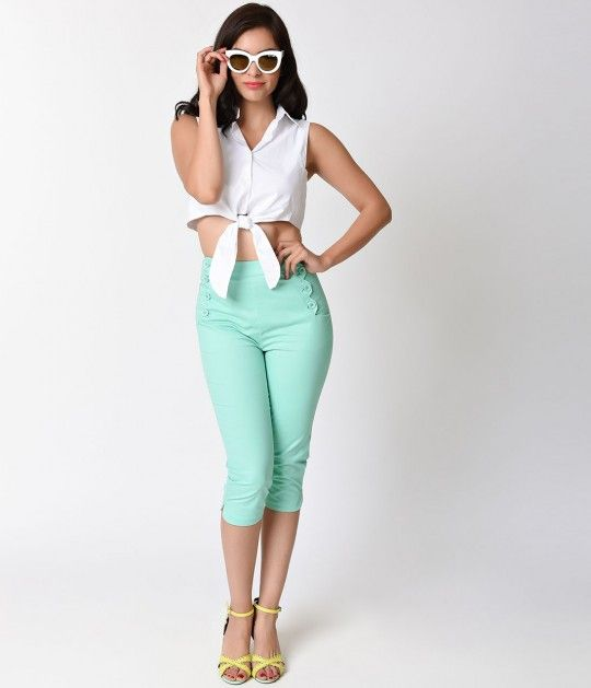 Mind if we mint? Cut to flatter with comfortable stretch, these mint capris are a pristine pair of polished pants! Crafted in a soft stretch cotton and featuring a vintage high waist with sweet button detail, side pockets and a hidden back zipper. A notch