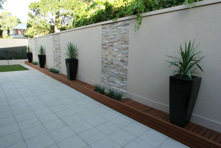 Outdoor entertaining area foamfast fence cladding for Barda de madera para jardin
