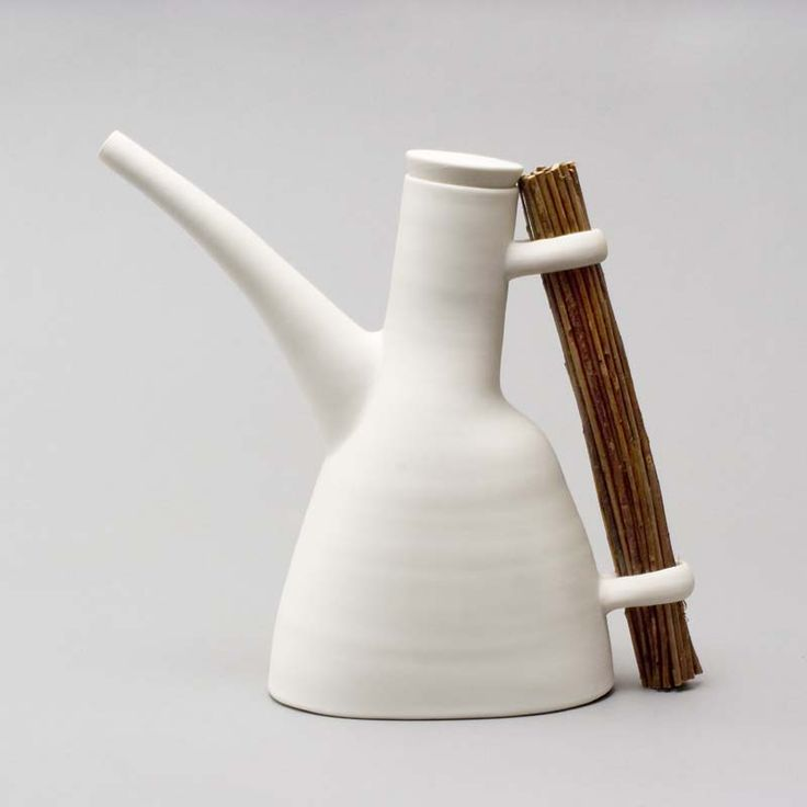 Ann Linnemann's perfectly balanced ceramic teapot. I love the balance of left-leaning and right-leaning elements as well as the balance of the earthy clay and twigs.
