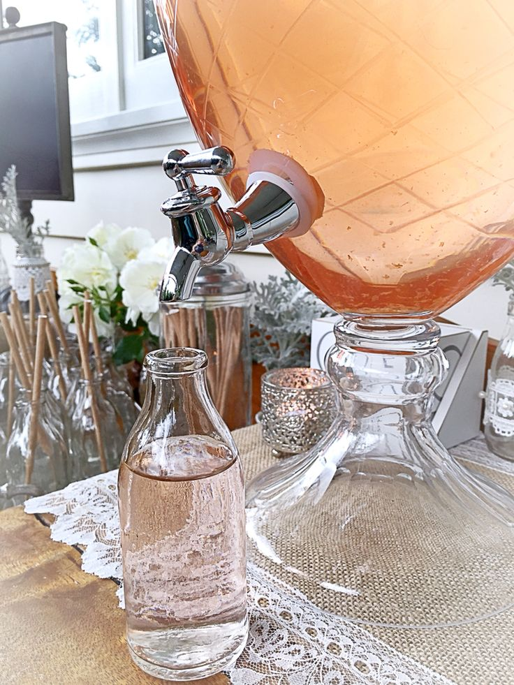 Beautiful etched glass drinks dispenser with cute mini glass bottles