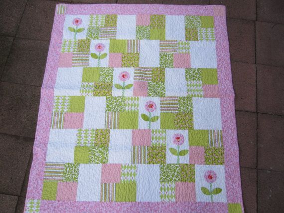 I created this darling toddler quilt with flowers in mind for sure!  Pink and white beauty measuring 44 X 50.  I used all cotton quilt shop