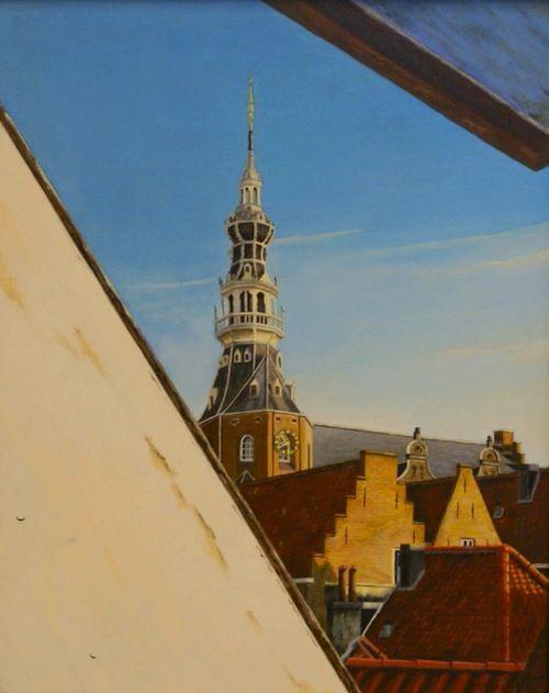 dakraam met zicht op toren van het voormalige stadhuis van Zierikzee