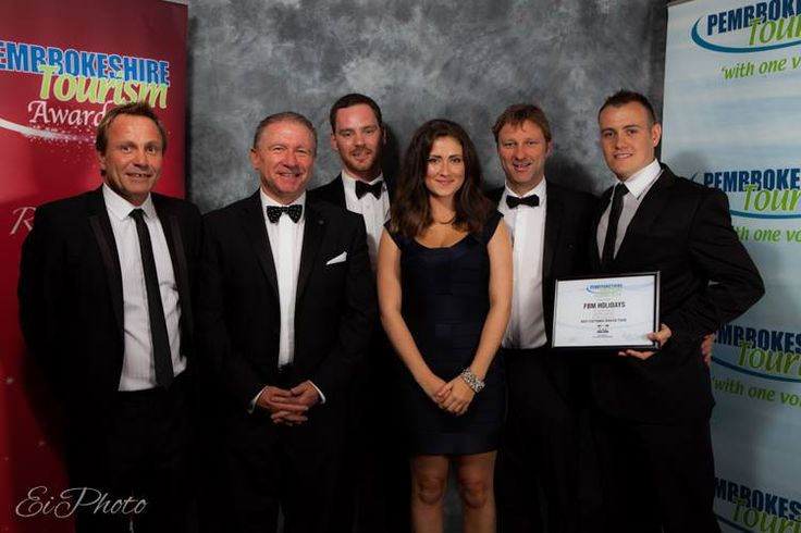Dominic Subbiani, Gillan Williams, Georgia Busby, Tim Brace and Billy Connor receiving the silver award for the Best Customer Service Team at the Pembrokeshire Tourism Awards.