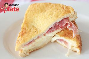 Mozzarella in Carrozza is the answer to how an Italian enjoys a Grilled Cheese Sandwich! Try out this twist on a family favourite and spoil your tastebuds with mozzarella oozing on top of Prosciutto di Parma between two fried slices of bread.