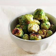 Maple Roasted Brussel Sprouts  Serves 2-4 Prep Time: 20 minutes Cook Time: 20 minutes  1 large stalk brussels sprouts (2-3 cups) 1 tablespoon extra virgin olive oil 2 teaspoons maple syrup Salt and pepper, to taste  Preheat oven to 400F.  Cut the brussels sprouts from the stalk. Remove the stem and outer leaves.  In a large mixing bowl, toss the brussels sprouts with the olive oil and maple syrup. Spread the sprouts on a large baking sheet and bake at 400F for 20 minutes.