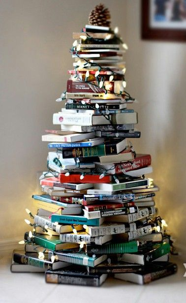A book lover's dream! A Christmas tree made from a stack of books. The fairy lights and cone make it even better!