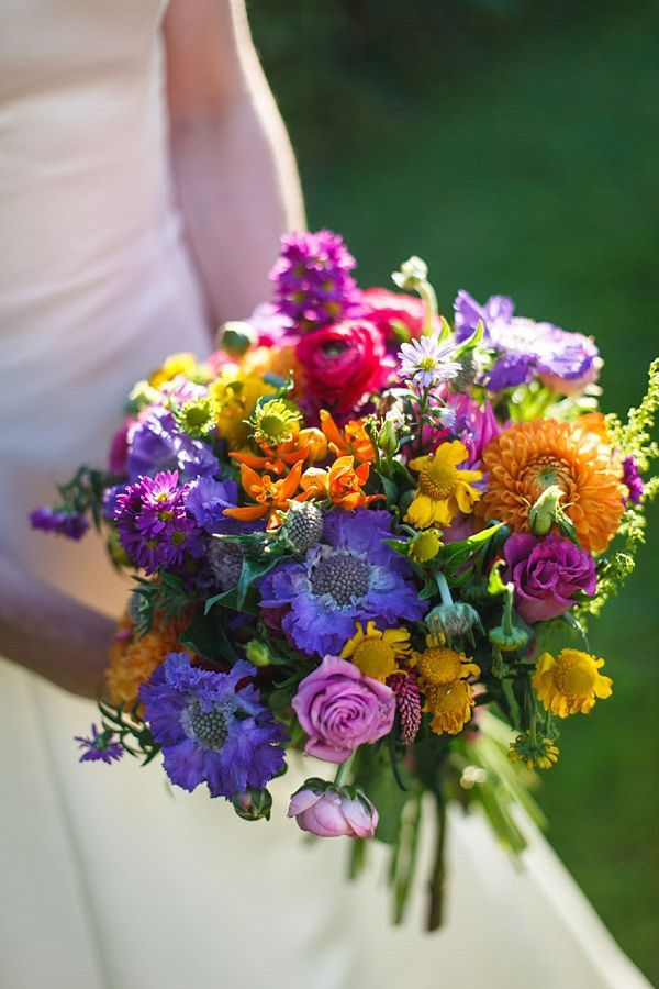 A Bright and Colourful Somerset Marquee Wedding Bouquet with orange, purple, pink and green.
