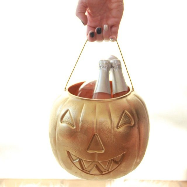 Spray paint gold a $1 bucket for a chic ice bucket to hold your Halloween champange