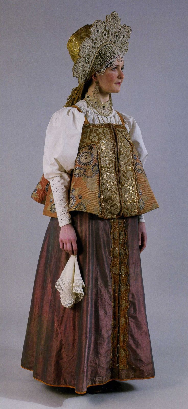 wedding costume. XIX century. Archangelsk region. Headdress for maidens- povyazka (here-high headdress with forehead ornament). wedding headdress- venetc (looks like kokoshnik). bride`s head shawl- shirinka. shirt, dushegreya (sleeveless), sarafan (dress). there are two types of headdresses because it is a symbol of her past live as maiden and future-as adult woman, that`s why she wears maiden and woman headdresses