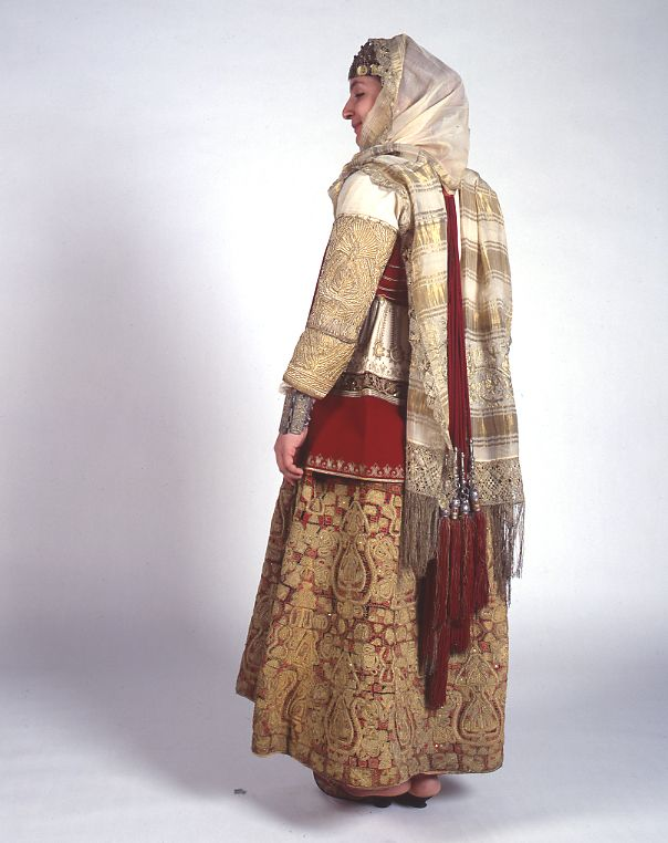 A version of the Attica bridal dress worn in all the villages round Athens. The chemise border embroidery composed of extremely difficult and imaginative motifs, was often covered with gold embroidery, a gift from the bride groom to the bride. - mi 19th