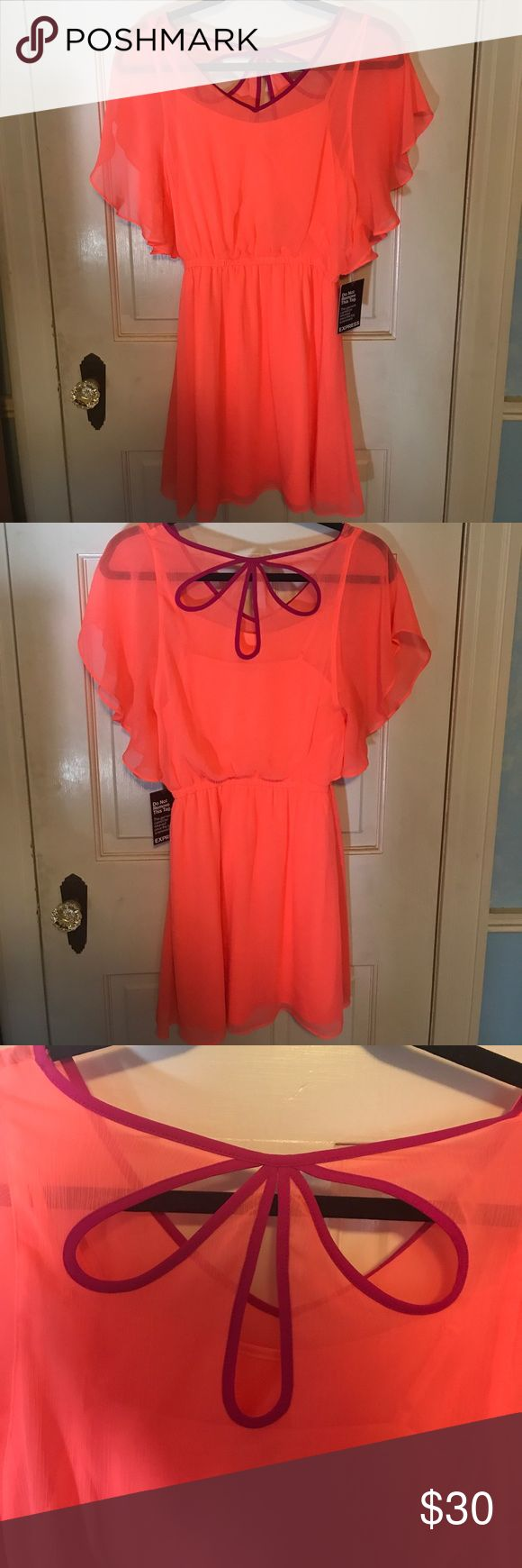 Coral/orange mini dress with pink detail NWT Coral/orange mini dress from Express. Perfect for a summer event when you want to stand out in a bright color. Never worn Express Dresses Mini