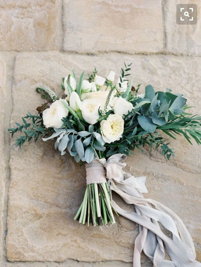 I love this bouquet style... Lots of greenery, messy and pretty trailing ribbons.  I prefer silver dollar eucalyptus though...