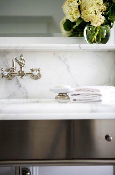 Sage Design: Stunning bathroom vanity with marble slab countertop & backsplash and wall-mount faucet ...