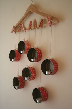 Looks like tin cans with fabric. Kind of a cute idea, or make a variation of this idea.