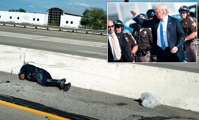 Indianapolis cop falls off his motorcycle escorting Trump | Daily Mail Online