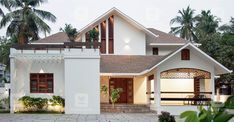 The House Exudes The Natural Elegance Of Minimalism Yet Has All The Modern Facilities I Kerala House Design Contemporary House Plans Contemporary House Design