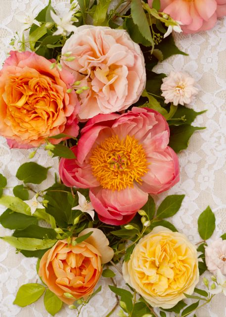 Roses and peonies in shades of yellow, apricot, peach and pink