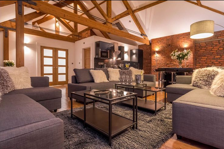 Eleska House on Dale Street Manchester top floor flat living area with exposed timber roof trusses