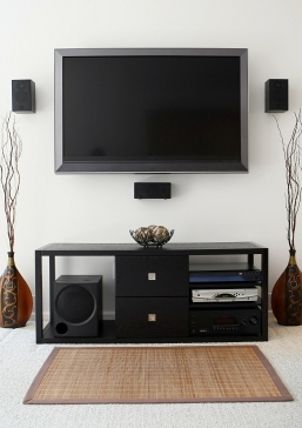 Wall mounted tv and small entertainment center.  Hidden wires...nice...
