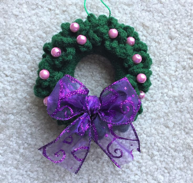 Crocheted Wreath Christmas Ornamant - Purple Ribbon, Wreath Package Trim by CogansCreations on Etsy https://www.etsy.com/listing/562248666/crocheted-wreath-christmas-ornamant