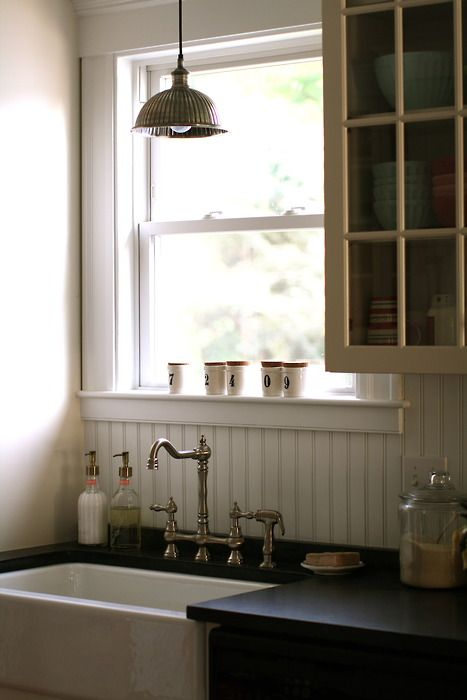 Simple country kitchen, love the sink, faucet wanes-coating, and ceiling light!