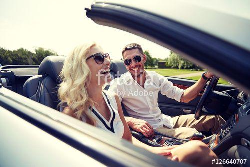 """Laden Sie das lizenzfreie Foto """"happy man and woman driving in cabriolet car"""" von Syda Productions zum günstigen Preis auf Fotolia.com herunter. Stöbern Sie in unserer Bilddatenbank und finden Sie schnell das perfekte Stockfoto für Ihr Marketing-Projekt!"""