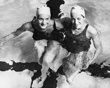 America's Anne Curtis, left, with Karen Harup of Denmark after they had finished the women's Olympic Games 400-metres Freestyle Final at the Empire Pool, Wembley, London, Aug. 7, 1948. Curtis won the race , with Harup taking second place. The first five in the race all beat the Olympic Record time that had been set in 1936. (AP Photo)