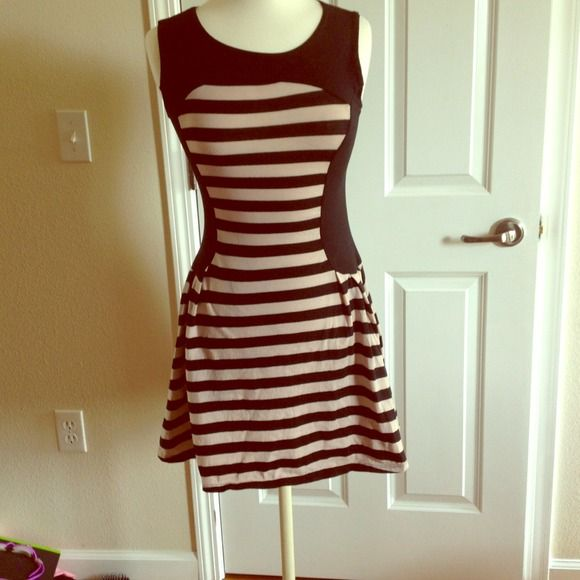 Black and grey stripes short dress small juniors This in style right now, you can wear it with a cute pair of heels and you be styling.  Super cute! no brand  Dresses