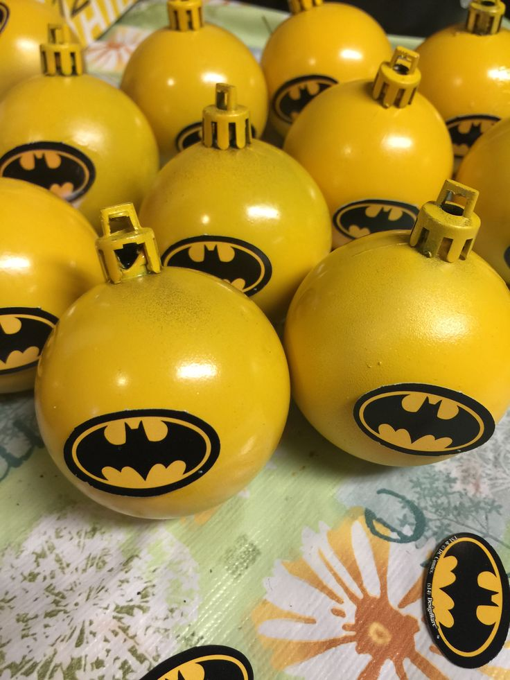 Batman ornaments for my Christmas tree theme this year! Bought 12 ornaments for a dollar, spray painted yellow, and affixed batman logo!