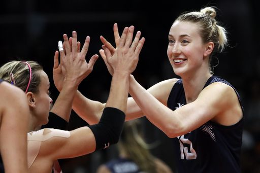 Top-ranked US women's volleyball team goes unbeaten in group:   August 14, 2016  -    United States' Kim Hill, right, greets teammate Kayla Banwarth during a women's preliminary volleyball match against China at the 2016 Summer Olympics in Rio de Janeiro, Brazil, Sunday, Aug. 14, 2016. (AP Photo/Matt Rourke)