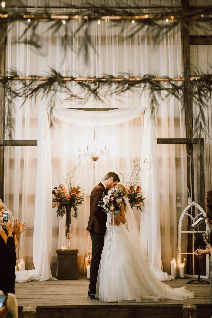 First kiss as husband and wife | Image by Ariana Tennyson Photography