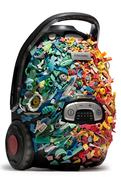 """an 'artwork' created by South African artist Simon Max Bannister for project """"Vac from the Sea"""", using an eco-friendly vacuum cleaner as his canvas for recycled plastic pieces gathered from a beach cleanup"""