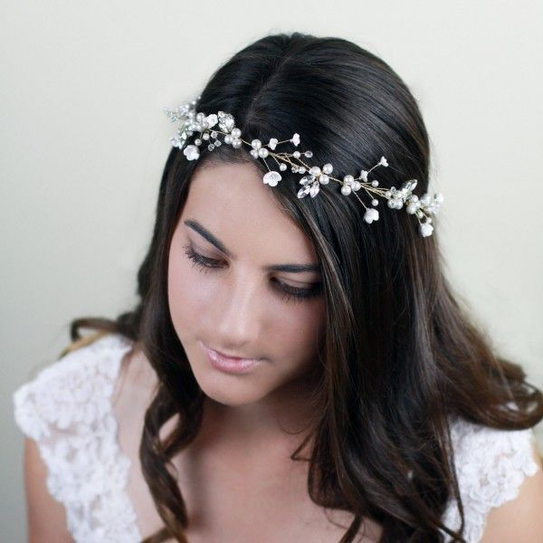 Simply divine! Olivia bridal Headpieces has handmade flowers and stunning beads