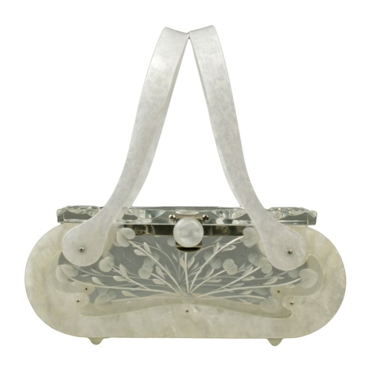 1950's Double Carved Vintage Lucite Handbag by Rialto   From a collection of rare vintage handbags and purses at https://www.1stdibs.com/fashion/handbags-purses-bags/handbags-purses-bags/