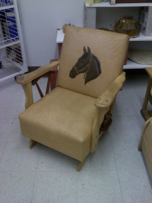 The chair from an incredible five piece set of Western leather furniture with wagon wheel spoke accents.