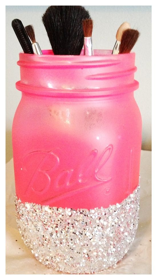 Painted and glitter dipped mason jar as a makeup brush holder. Cute!.
