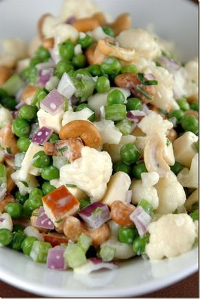 I make a similar salad- I use green onions instead of red, and also add bacon bits.  I like the idea of the cheese-- will have to try it.