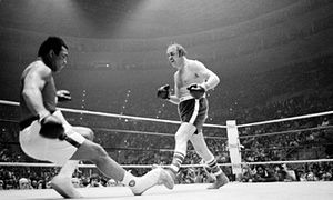 Defending heavyweight champion Muhammad Ali goes down after a punch from Chuck Wepner in Cleveland, Ohio, in 1975.