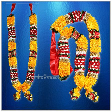 Artificial Garlands for weddings and Goddess Puja Haar Vedicvaani.com Antic garlands for god online, Satin flowers Mala, Deity Haar. Colorful Deity Garland, Artificial garland made of Satin flowers in red and golden color. Flower garlands have the capacity of uplifting the aura of any place, a smile on your face just through their presence. These garlands are ideal for offering on deity idols, altar, entrance doors. It is a sign of welcoming and invoking the blessings of a deity.
