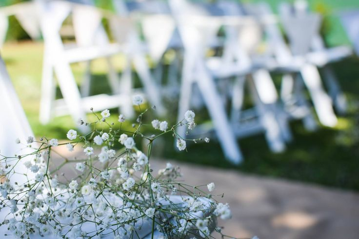 Gyp and white timber chairs for the wedding ceremony.