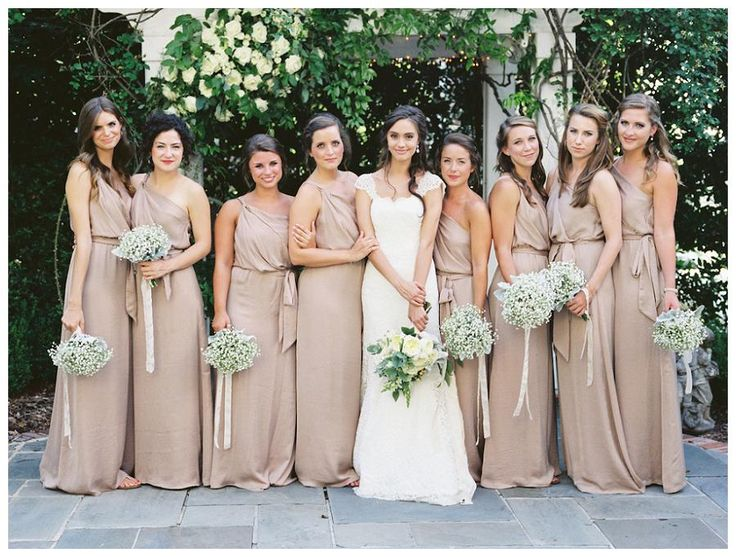 Neutral bridesmaid dresses and white bouquets // Weddings Unveiled