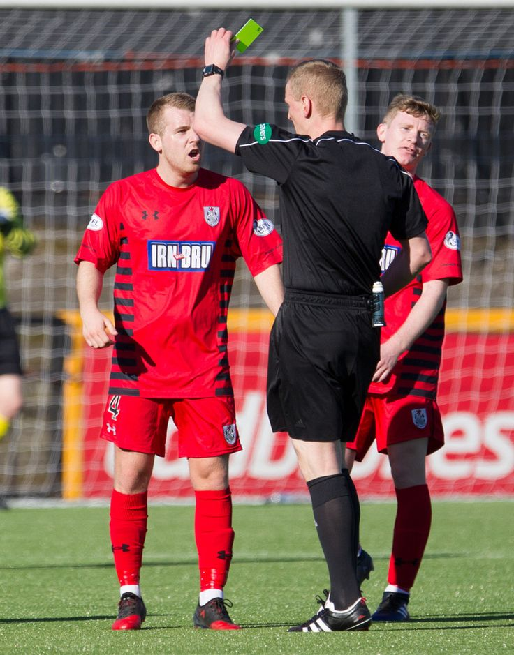 Queen's Park's Jamie McKernon is booked during the Ladbrokes League One game between Alloa Athletic and Queen's Park.