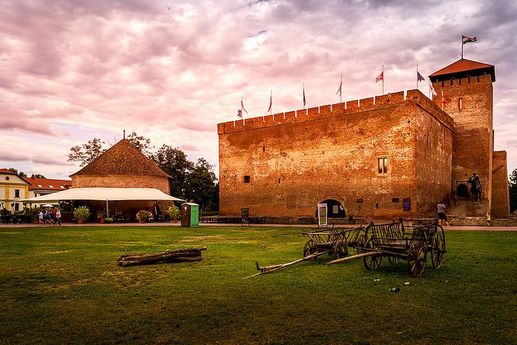 "In this post I have decided to share another photo of the old medieval castle of Gyula at sunset. This photo was taken on Monday after 7 o'clock PM when the sun started slowly to set. As you can see there were only a few people walking near the castle. Unfortunately, on the hot summer weekends, the … Continue reading ""Another Sunset Photo Over The Old Medieval Castle"""
