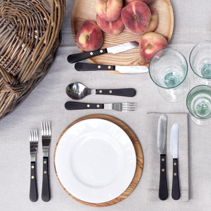 Summer dining inspiration. David Mellor Provencal cutlery, fine bone china, hand turned ash platter, recycled Spanish glassware, Norfolk basket and natural table linen. #summertable #tabletop #provencal #davidmellor