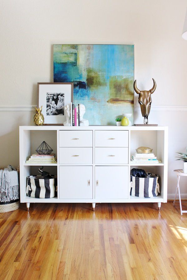 Console—This Kallax unit gets Hollywood Regency style with the addition of some drawers, stylish hardware, and legs.