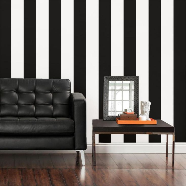 Exotic Living Room Interior Design With White Black Striped Paint Wall And Leather Sofa
