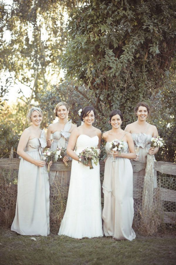 What a lovely shot of our bride & her gorgeous girls.  Loving the light beige dresses & softly upswept hair! Photograph by Truly Madly Photographers http://www.storyboardwedding.com/australian-country-farm-wedding-featuring-a-private-tasmania-farm-complete-with-shabby-chic-touches/