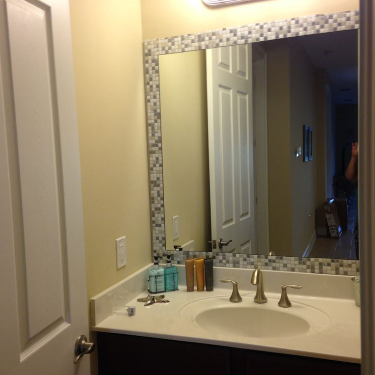 Take self adhesive tiles bought from homedepot.com and add as a border around a boring mirror. Many options to chose from and can be cut with scissors. No tile saw, adhesives or grout needed. No mess and took less than an hour.