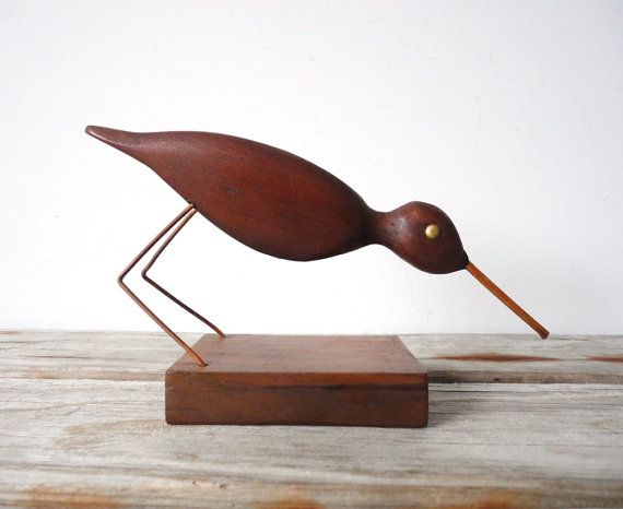 A gorgeous modern bird figure, hand carved out of solid teak wood. Gorgeous wood grain throughout. In great condition.$75